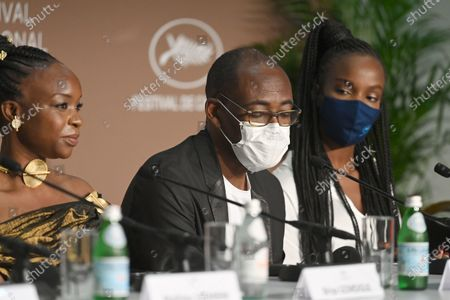 Achouackh Abakar Souleymane, Mahamat-Saleh Haroun and Rihane Khalil Alio attend the 'Lingui' press conference during the 74th annual Cannes Film Festival, in Cannes, France, 09 July 2021. The movie is presented in the Official Competition of the festival which runs from 06 to 17 July.
