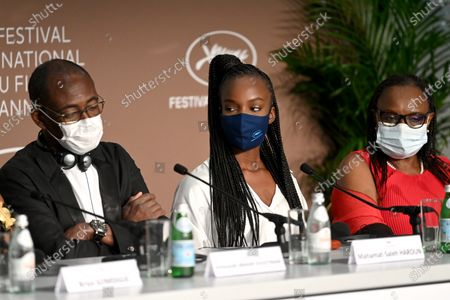 Mahamat-Saleh Haroun, Rihane Khalil Alio and Hadje Fatime Ngoua attend the 'Lingui' press conference during the 74th annual Cannes Film Festival, in Cannes, France, 09 July 2021. The movie is presented in the Official Competition of the festival which runs from 06 to 17 July.