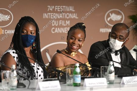 Stock Photo of Bria Gomdigue, Achouackh Abakar Souleymane and Mahamat-Saleh Haroun attend the 'Lingui' press conference during the 74th annual Cannes Film Festival, in Cannes, France, 09 July 2021. The movie is presented in the Official Competition of the festival which runs from 06 to 17 July.