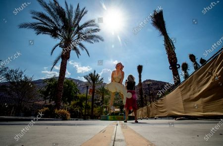 As the sun beats down on the Forever Marilyn statue, tourists stop for quick photos in 110 degree temperatures on July 8, 2021 in downtown Palm Springs, California. Another heat wave is expected this weekend in Southern California.(Gina Ferazzi / Los Angeles Times)