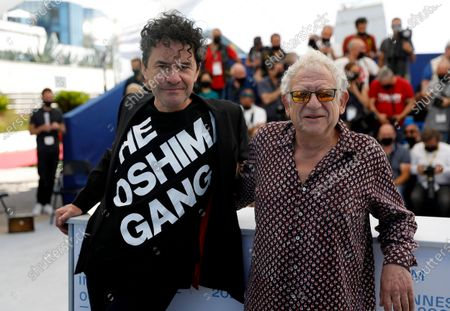 Jeremy Thomas (R) poses with director Mark Cousins (L) during the photocall for 'The Storms Of Jeremy Irons' at the 74th annual Cannes Film Festival, in Cannes, France, 09 July 2021. The movie is presented in the Official Competition of the festival which runs from 06 to 17 July.