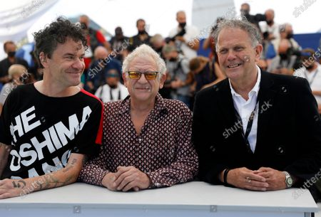 Producers David P. Kelly (R) and Jeremy Thomas (C) pose with director Mark Cousins (L) during the photocall for 'The Storms Of Jeremy Irons' at the 74th annual Cannes Film Festival, in Cannes, France, 09 July 2021. The movie is presented in the Official Competition of the festival which runs from 06 to 17 July.