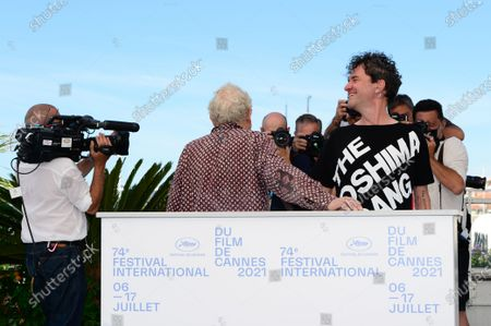 Jeremy Thomas (L) and director Mark Cousins pose during the photocall for 'The Storms Of Jeremy Thomas' at the 74th annual Cannes Film Festival, in Cannes, France, 09 July 2021. The festival runs from 06 to 17 July.