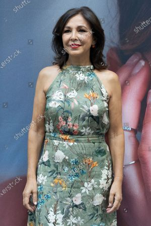 Stock Image of Isabel Gemio attends a photocall for inauguration of David Locco Atelier in Madrid.