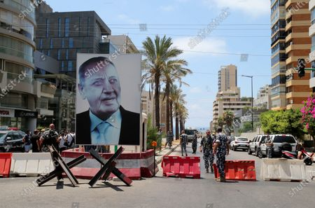 A giant portrait of Parliament Speaker Nabih Berri as soldiers block access to Ain al-Tineh Palace, the residence of the Parliament Speaker, in Beirut, Lebanon, 09 July 2021. Families of some victims of 04 August 2020 Beirut port explosion gathered to protest at the Ain al-Tineh palace where the Parliament's Administration and Justice Committee was meeting to debate on the immunity of three MPs to be investigated in the case of the Beirut port explosion. A massive blast on 04 August 2020 rocked Beirut's port in which at least 200 people were killed and more than 6,000 injured,  believed to have been caused by an estimated 2,750 tons of ammonium nitrate stored in a warehouse, devastated the port area of Beirut and several parts of the city.