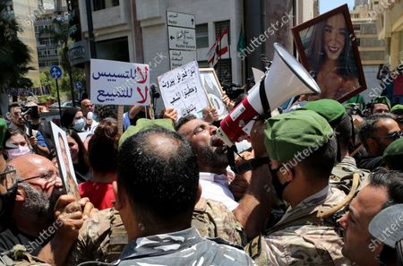 Releatives of deceased family members protest as soldiers block access to Ain al-Tineh Palace, the residence of the Parliament Speaker, in Beirut, Lebanon, 09 July 2021. Families of some victims of 04 August 2020 Beirut port explosion gathered to protest at the Ain al-Tineh palace where the Parliament's Administration and Justice Committee was meeting to debate on the immunity of three MPs to be investigated in the case of the Beirut port explosion. A massive blast on 04 August 2020 rocked Beirut's port in which at least 200 people were killed and more than 6,000 injured,  believed to have been caused by an estimated 2,750 tons of ammonium nitrate stored in a warehouse, devastated the port area of Beirut and several parts of the city.
