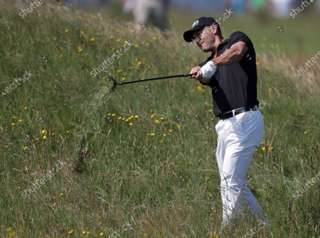 Stock Picture of Martin Kaymer (GER) plays from deep rough on the 2nd hole; Royal St Georges Golf Club, Sandwich, Kent, England; The Open Championship, PGA Tour, European Tour Golf, First Round .