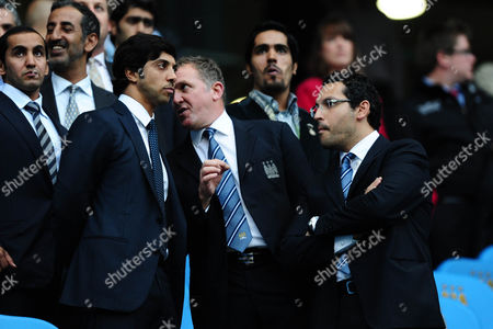 Manchester City owner Sheikh Mansour talks to Chief Executive Garry Cook