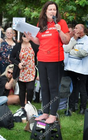 Stock Image of Jeanette Archer speaks to a crowd of protesters claiming herself a survivor of satanic ritual abuse during the demonstration.Protesters gather together in Hyde Park, London to expose Satanic Ritual Abuse. The group want to bring this type of child abuse into the open and expose high ranking Satanists that they say hold powerful positions in the UK.