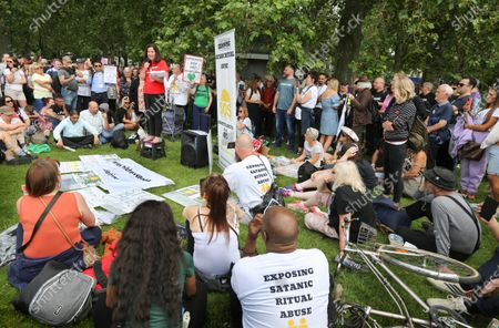 Jeanette Archer speaks to a crowd of protesters claiming herself a survivor of satanic ritual abuse during the demonstration.Protesters gather together in Hyde Park, London to expose Satanic Ritual Abuse. The group want to bring this type of child abuse into the open and expose high ranking Satanists that they say hold powerful positions in the UK.