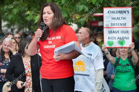 Stock Photo of Jeanette Archer speaks to a crowd of protesters claiming herself a survivor of satanic ritual abuse during the demonstration.Protesters gather together in Hyde Park, London to expose Satanic Ritual Abuse. The group want to bring this type of child abuse into the open and expose high ranking Satanists that they say hold powerful positions in the UK.