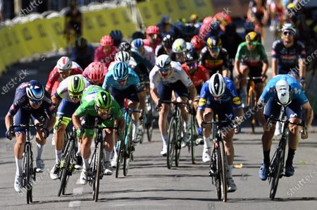 Stock Picture of British Mark Cavendish of Deceuninck - Quick-Step wins ahead of Belgian Jasper Philipsen of Alpecin-Fenix and Danish Michael Morkov of Deceuninck - Quick-Step in stage 13 of the 108th edition of the Tour de France cycling race, from Nimes to Carcassonne (219,9 km) in France, Friday 09 July 2021. This year's Tour de France takes place from 26 June to 18 July 2021.