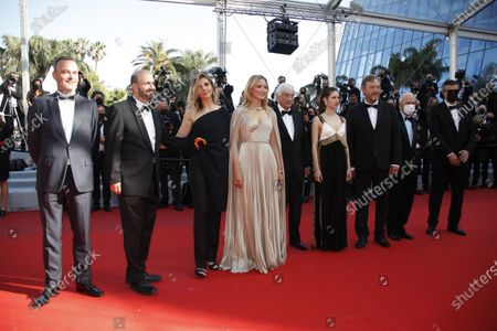Michel Merkt, David Birke, Clotilde Courau, Virginie Efira, director Paul Verhoeven, Daphne Patakia, Olivier Rabourdin, a guest, and Said Ben Siïd arrive for the screening of 'Benedetta' during the 74th annual Cannes Film Festival, in Cannes, France, 09 July 2021. The movie is presented in the Official Competition of the festival which runs from 06 to 17 July.