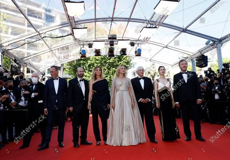 (2L-R) Michel Merkt, David Birke, Clotilde Courau, Virginie Efira, director Paul Verhoeven, Daphne Patakia, and Olivier Rabourdin arrive for the screening of 'Benedetta' during the 74th annual Cannes Film Festival, in Cannes, France, 09 July 2021. The movie is presented in the Official Competition of the festival which runs from 06 to 17 July.
