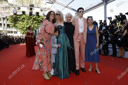 Stock Picture of Josh O'Connor (3-R), Eva Husson (R), Elizabeth Karlsen (L), Donna Mabey (2-L) and Morgan Kibby (3-L) with an unidentified child arrive for the screening of 'Benedetta' during the 74th annual Cannes Film Festival, in Cannes, France, 09 July 2021. The movie is presented in the Official Competition of the festival which runs from 06 to 17 July.
