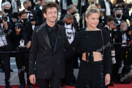 Nahuel Perez Biscayart (L) and Justine Bustos arrive for the screening of 'Benedetta' during the 74th annual Cannes Film Festival, in Cannes, France, 09 July 2021. The movie is presented in the Official Competition of the festival which runs from 06 to 17 July.