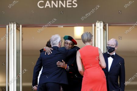 Jury President Spike Lee (2-L) and Tonya Lewis Lee (2-R) are greeted by Cannes Film Festival General Delegate Thierry Fremaux (L) and Cannes Film Festival President Pierre Lescure (R) as they arrive for the screening of 'Benedetta' during the 74th annual Cannes Film Festival, in Cannes, France, 09 July 2021. The movie is presented in the Official Competition of the festival which runs from 06 to 17 July.