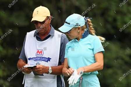 Natalie Gulbis of Lake Las Vegas, Virginia talks with her caddy before hitting from the 11th tee during the second round of the Marathon LPGA Classic golf tournament at Highland Meadows Golf Club in Sylvania, Ohio, USA Friday, July 9, 2021.