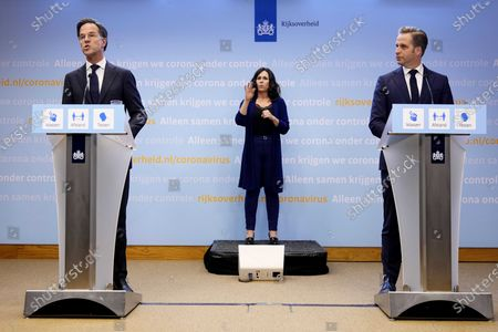 Dutch outgoing Prime Minister Mark Rutte (L) and outgoing Dutch Minister of Health Hugo de Jonge (R) during an extra press conference in the Hague, The Netherlands, 09 July 2021. The cabinet takes measures to deal with the sharp increase in the number of positive corona infections.