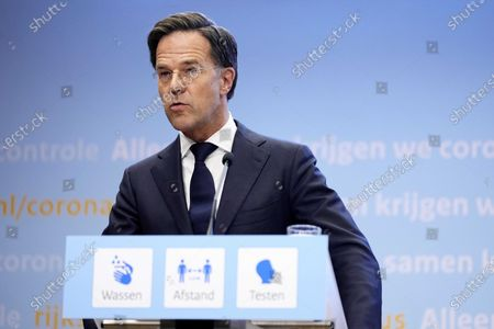 Dutch outgoing Prime Minister Mark Rutte speaks during an extra press conference in the Hague, The Netherlands, 09 July 2021. The cabinet takes measures to deal with the sharp increase in the number of positive corona infections.