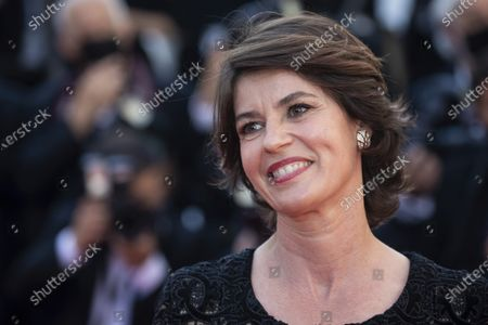 Irene Jacob poses for photographers upon arrival at the premiere of the film 'Benedetta' at the 74th international film festival, Cannes, southern France