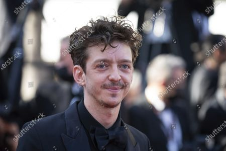 Nahuel Perez Biscayart poses for photographers upon arrival at the premiere of the film 'Benedetta' at the 74th international film festival, Cannes, southern France