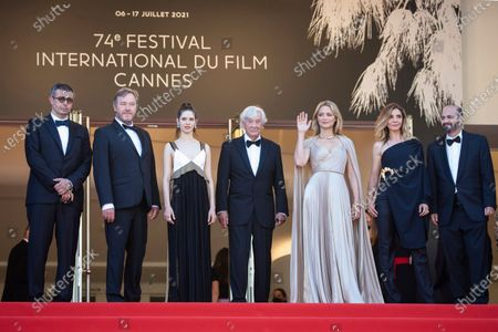 Said Ben Said, from left, Olivier Rabourdin, Daphne Patakia, director Paul Verhoeven, Virginie Efira, Clotilde Courau, David Birke, and Michel Merkt pose for photographers upon arrival at the premiere of the film 'Benedetta' at the 74th international film festival, Cannes, southern France