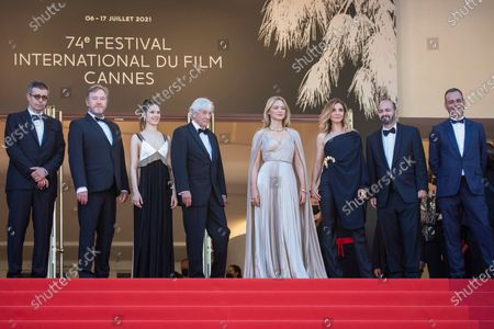 Stock Photo of Said Ben Said, from left, Olivier Rabourdin, Daphne Patakia, director Paul Verhoeven, Virginie Efira, Clotilde Courau, David Birke, and Michel Merkt pose for photographers upon arrival at the premiere of the film 'Benedetta' at the 74th international film festival, Cannes, southern France
