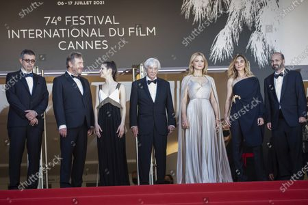 Stock Image of Said Ben Said, from left, Olivier Rabourdin, Daphne Patakia, director Paul Verhoeven, Virginie Efira, Clotilde Courau, David Birke, and Michel Merkt pose for photographers upon arrival at the premiere of the film 'Benedetta' at the 74th international film festival, Cannes, southern France