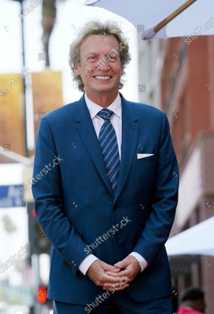 Television producer Nigel Lythgoe poses at a ceremony honoring him with a star on the Hollywood Walk of Fame on his birthday, in Los Angeles. The ceremony was initially scheduled for April 1, 2020, but was postponed due to the coronavirus outbreak