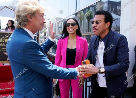 Television producer Nigel Lythgoe, left, greets singer Lionel Richie and his girlfriend Lisa Parigi at a ceremony honoring Lythgoe with a star on the Hollywood Walk of Fame on his 72nd birthday, in Los Angeles. The ceremony was initially scheduled for April 1, 2020, but was postponed due to the coronavirus outbreak