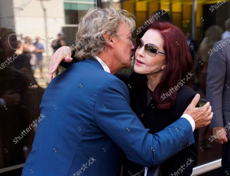 Television producer Nigel Lythgoe, left, greets Priscilla Presley at a ceremony honoring him with a star on the Hollywood Walk of Fame on his 72nd birthday, in Los Angeles. The ceremony was initially scheduled for April 1, 2020, but was postponed due to the coronavirus outbreak