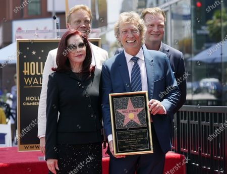 Television producer Nigel Lythgoe, front right, poses with, from left, Priscilla Presley, and his sons Simon and Kristopher at a ceremony honoring him with a star on the Hollywood Walk of Fame on his 72nd birthday, in Los Angeles. The ceremony was initially scheduled for April 1, 2020, but was postponed due to the coronavirus outbreak