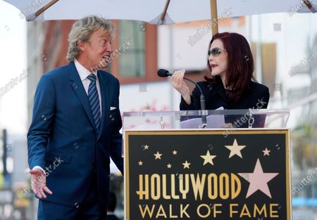 Priscilla Presley, right, speaks at a ceremony honoring television producer Nigel Lythgoe, left, with a star on the Hollywood Walk of Fame on his 72nd birthday, in Los Angeles. The ceremony was initially scheduled for April 1, 2020, but was postponed due to the coronavirus outbreak