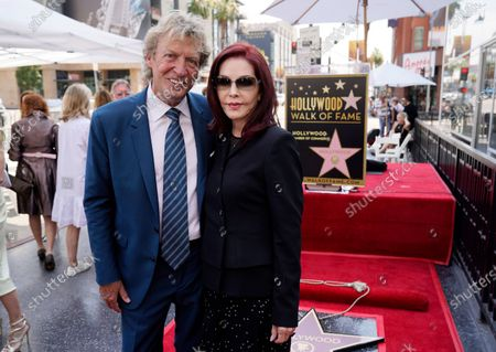 Television producer Nigel Lythgoe poses with Priscilla Presley at a ceremony honoring him with a star on the Hollywood Walk of Fame on his 72nd birthday, in Los Angeles. The ceremony was initially scheduled for April 1, 2020, but was postponed due to the coronavirus outbreak