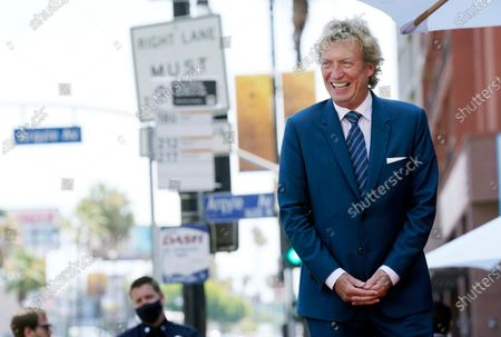 Television producer Nigel Lythgoe looks out at the audience at a ceremony honoring him with a star on the Hollywood Walk of Fame on his 72nd birthday, in Los Angeles. The ceremony was initially scheduled for April 1, 2020, but was postponed due to the coronavirus outbreak