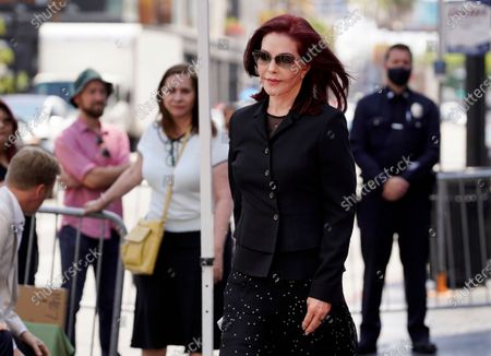 Priscilla Presley walks to her seat at a ceremony honoring television producer Nigel Lythgoe with a star on the Hollywood Walk of Fame, in Los Angeles