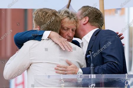 Television producer Nigel Lythgoe, center, embraces his sons Simon, left, and Kristopher at a ceremony honoring him with a star on the Hollywood Walk of Fame on his 72nd birthday, in Los Angeles. The ceremony was initially scheduled for April 1, 2020, but was postponed due to the coronavirus outbreak