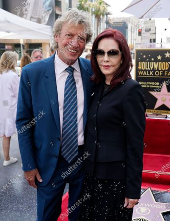 Television producer Nigel Lythgoe, left, poses with Priscilla Presley at a ceremony honoring him with a star on the Hollywood Walk of Fame on his 72nd birthday, in Los Angeles. The ceremony was initially scheduled for April 1, 2020, but was postponed due to the coronavirus outbreak