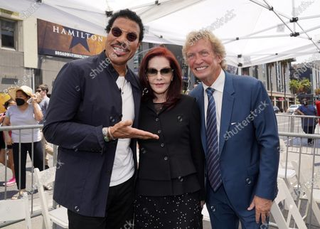 Television producer Nigel Lythgoe, right, poses with singer Lionel Richie, left, and Priscilla Presley at a ceremony honoring him with a star on the Hollywood Walk of Fame on his 72nd birthday, in Los Angeles. The ceremony was initially scheduled for April 1, 2020, but was postponed due to the coronavirus outbreak