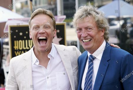Television producer Nigel Lythgoe, right, poses with his son Simon at a ceremony honoring him with a star on the Hollywood Walk of Fame on his 72nd birthday, in Los Angeles. The ceremony was initially scheduled for April 1, 2020, but was postponed due to the coronavirus outbreak