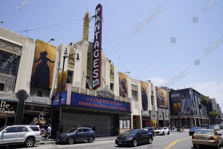 The marquee at the Hollywood Pantages Theatre sends a congratulatory message near a ceremony honoring television producer Nigel Lythgoe with a star on the Hollywood Walk of Fame on his 72nd birthday, in Los Angeles. The ceremony was initially scheduled for April 1, 2020, but was postponed due to the coronavirus outbreak