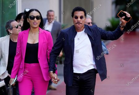 Lionel Richie and his girlfriend Lisa Parigi arrive at a ceremony honoring television producer Nigel Lythgoe with a star on the Hollywood Walk of Fame, in Los Angeles. The ceremony was initially scheduled for April 1, 2020, but was postponed due to the coronavirus outbreak