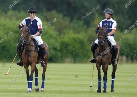 Prince William and Mark Tomlinson play in the Out-Sourcing Inc. Royal Charity Polo Cup, at Guards Polo Club, Windsor, Berkshire, UK, on the 9th July 2021.