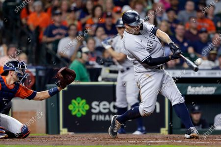New York Yankees' Gary Sanchez, right, connects in front of Houston Astros catcher Jason Castro, left, during a baseball game, in Houston