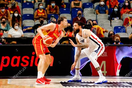 Stock Photo of Pau Gasol of Spain and Vincent Poiriere of France seen in action during Spain vs France friendly match of basketball at Palacio de los Deportes Jose Maria Martin Carpena in Malaga prior to Tokyo 2020 Olympic Games. Final Score; Spain 86:77 France