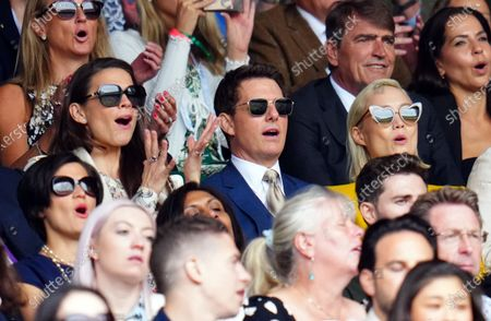 Hayley Atwell,  Tom Cruise and Pom Klementieff watching the action on Centre Court during the Ladies' Singles final