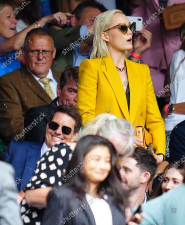 Tom Cruise and Pom Klementieff watching the action on Centre Court during the Ladies' Singles final