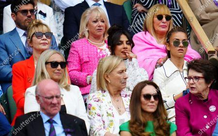 Lulu alongside Priyanka Chopra Jonas as Martina Navratilova and Billie Jean King and Elaine Paige look on behind the Duchess of Cambridge