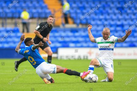 Tranmere Rovers midfielder Jay Spearing (8) and Ranger's FC forward Jermaine Defoe (9) challenge for the ball during the Pre-Season Friendly match between Tranmere Rovers and Rangers at Prenton Park, Birkenhead